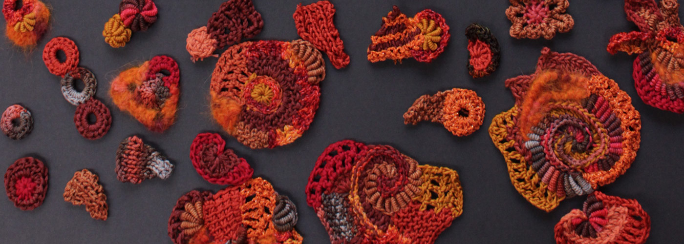 red and orange knitted and crocheted scrumbles